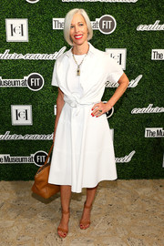 Linda Fargo attended the Couture Council Award luncheon wearing a white dress with a matching tie-waist bolero.
