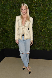 Poppy Delevingne contrasted her jacket with a pair of grunge-chic jeans.