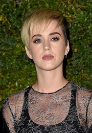Katy Perry attended the celebration of Chanel's Gabrielle bag wearing her hair in an edgy pixie.