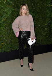Bella Heathcote kept it laid-back yet chic in a loose pink boatneck sweater at the celebration of Chanel's Gabrielle bag.