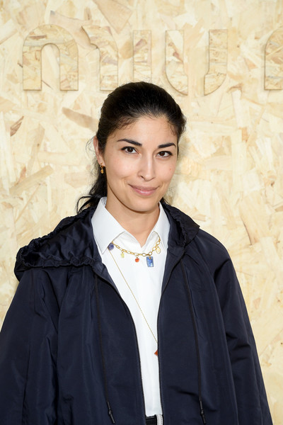 Caroline Issa Gold Charm Necklace [miu miu : outside arrivals,outerwear,coat,smile,black hair,summer 2020,caroline issa,miu miu womenswear spring,part,paris,france,paris fashion week,show]