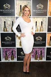 Carrie Keagan sported a figure-flattering long-sleeved frock while out at the Magnifico Giornata launch event in NYC.