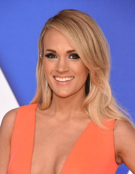 Carrie Underwood Long Side Part [hair,blond,face,hairstyle,chin,eyebrow,layered hair,long hair,surfer hair,brown hair,arrivals,carrie underwood,cma awards,nashville,tennessee,bridgestone arena]