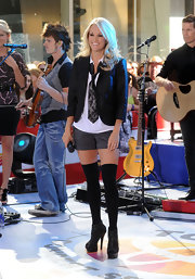 "Carrie hit the stage on the ""Today"" show sporting a preppy menswear-inspired ensemble with eye-catching crystal Ginny booties."