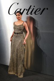 Freida Pinto was a vision in a gold tweed gown by Roland Mouret at the Santos de Cartier watch launch.