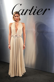 Sofia Boutella went vintage-glam in this pleated halter gown by Prada at the Santos de Cartier watch launch.