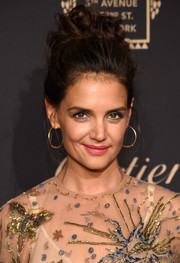 Katie Holmes attended the Cartier Fifth Avenue grand reopening wearing her hair in pinned-up ringlets.