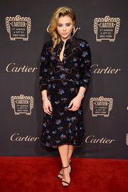 Chloe Grace Moretz was Western-chic in a printed shirtdress by Coach at the Cartier Fifth Avenue grand reopening.