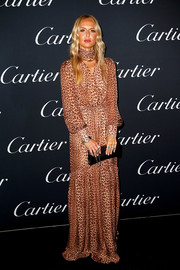 Rachel Zoe donned a flowing leopard-print dress from her own label for the Cartier Juste Un Clou event.