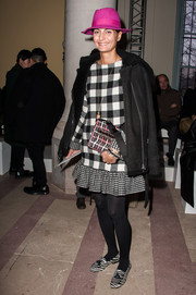 Giovanna Battaglia looked striking in a black moto jacket layered over a checkered top and mini combo at the Carven fashion show.