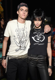 Kaia Gerber teamed a studded black belt with leather pants and a graphic tee for her Joan Jett costume.
