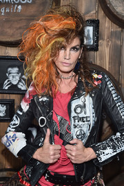 Cindy Crawford nailed the rock star look with this multicolored teased hairstyle at the Casamigos Tequila Halloween party.