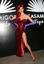 Alessandra Ambrosio channelled Jessica Rabbit in this sparkly red strapless gown during the Casamigos Tequila Halloween party.