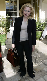 "Heiress, Casey Johnson, had a love for designer handbags. This brown, crocodile, ""Birkin"" bag with gold hardware adds to her sophisticated pant suit."