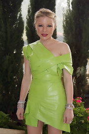 Casey pairs a very polished, Grecian-inspired updo with this lime green structured mini dress.