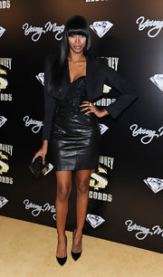 Jessica White looked luxe in a leather corset dress and cropped blazer for the pre-Grammy Awards party. The model added sparkle to her look with a hard case clutch.