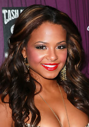 Christina Milian attended Cash Money Records' Lil Wayne album release party for 'Tha Carter IV' with rosy cheeks and vivid red lips.