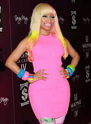 Nicki Minaj wore a long, flowing wig in shades of platinum blond, yellow pink and peach at the release party for Lil Wayne's album 'Tha Carter IV.'