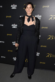 Carrie-Anne Moss attended the 'Jessica Jones' cast and crew discussion wearing a black spaghetti-strap jumpsuit.