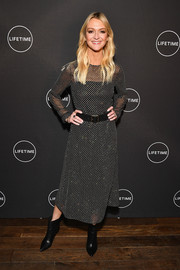 Zanna Roberts-Rassi styled her dress with a pair of black ankle boots.