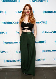 Molly Bernard paired her sexy top with green palazzo pants by Natalie Chapman.