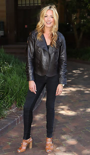 Cat Deeley looked rocker-chic at the Dancerstar soiree in Sydney in a black leather jacket paired with tan strappy sandals complete with studded detailing and a stacked heel.