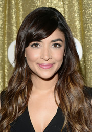Hannah Simone attended the Catdance Film Festival wearing her signature bangs swept to the side and the rest of her hair in cascading waves.