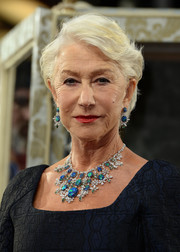 Helen Mirren jazzed up her black outfit with a stunning gemstone chandelier necklace.