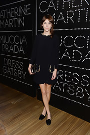 Alexa Chung's chose a classic LBD with chic gold detailing at the neck and pockets for her evening look.
