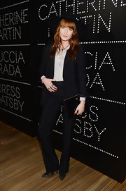 Florence Welch rocked a crisp and clean look at the Prada and Gatsby cocktail party where she wore this black pantsuit.