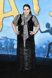Beanie Feldstein layered a shiny black gown over a leopard-print blouse for the world premiere of 'Cats.'