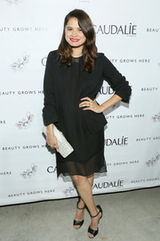 Melonie Diaz went for low-key elegance in a black blazer layered over a gauzy LBD during the Caudalie Boutique Spa grand opening.