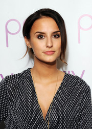 Lucy Watson styled her tresses into a loose bun for the launch of PRIV.