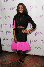 Aj Odudu injected an ultra-feminine touch with a black and neon-pink mermaid-hem skirt by ASOS.