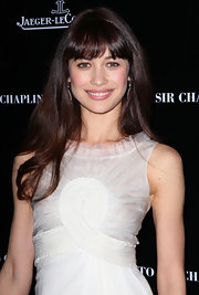 Olga Kurylenko attended the 40th Anniversary Celebration of Sir Charlie Chaplin's Honorary Academy wearing her straight hair long and flowing with wispy brow-length bangs.