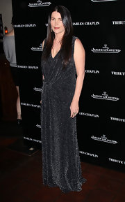 Julie Ormond wore this glittering faux wrap dress to the Charlie Chaplin Honorary Academy Award event.