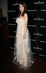 Dolores Chaplin wore this strapless frothy dress to the Charlie Chaplin Honorary Academy Award.