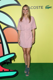 Gwyneth Paltrow styled her dress with blue cutout booties by Laurence Dacade.