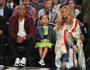 Beyonce Knowles cut a regal figure in a floral kimono by Gucci while watching the 66th NBA All-Star Game.