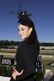 Megan Gale accessorized with a towering black feathered fascinator when she attended the AJC Australian Derby Day.