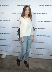 Katie Holmes completed her outfit with a pair of raw-hem bootcut jeans by Frame.