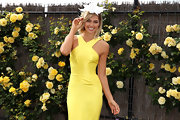 Ashley Hart wore a gorgeous decorative head piece at Crown Oaks Day.
