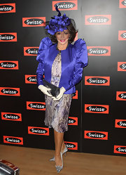 Joan Collins topped off her vibrant ensemble with satin silver pumps.