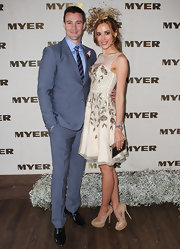 Rebecca Judd complemented her ensemble with gold platform pumps.