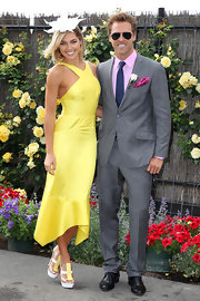 Ashley Hart was all smiles wearing a yellow halter day dress at the Crown Oaks Day.