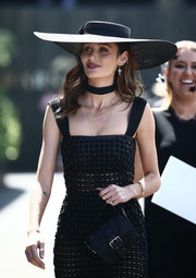 Nicole Trunfio paired a black wide-brimmed hat with a mesh dress for her Derby Day look.
