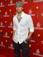 Enrique paired his army hat with a classic button down shirt.