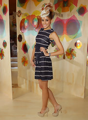 Rebecca wore a navy and white stripped day dress for Emirates Stakes Day.