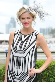 Brooklyn Decker got in the spirit of Race Day wearing this feathered statement head piece.