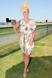Zara Phillips struck a pose at the Magic Millions Raceday event in a pretty print dress.